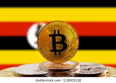 Bitcoin BTC on stack of cryptocurrencies with Uganda flag in background. The cryptocurrency coin is golden and in focus
