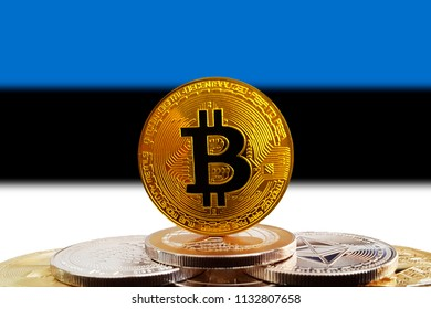Bitcoin BTC on stack of cryptocurrencies with Estonia flag in background. The cryptocurrency coin is golden and in focus