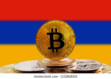 Bitcoin BTC on stack of cryptocurrencies with Armenia flag in background. The cryptocurrency coin is golden and in focus