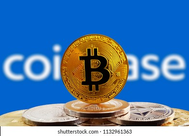 Bitcoin BTC on stack of cryptocurrencies with Coinbase logo in background. The cryptocurrency coin is golden and in focus. Copenhagen / Denmark - 07 13 2018