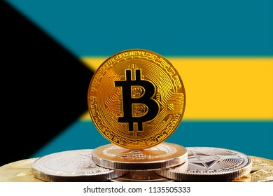 Bitcoin BTC on stack of cryptocurrencies with Bahamas flag in background. The cryptocurrency coin is golden and in focus