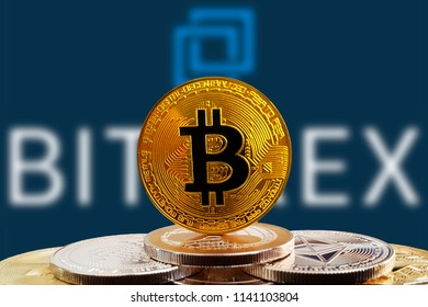 Bitcoin BTC on stack of cryptocurrencies with Bittrex exchange logo in background. The cryptocurrency coin is golden and in focus. Copenhagen / Denmark - 07 24 2018