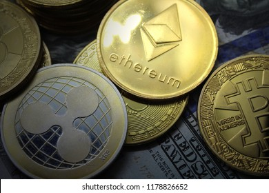 Bitcoin BTC Ripple XRP Etherium ETH coins on a Dollars.Crypto currency concept.Cryptocurrency consulting