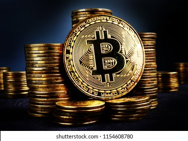 Bitcoin BTC and stacks of coins. Crypto stock exchange concept.