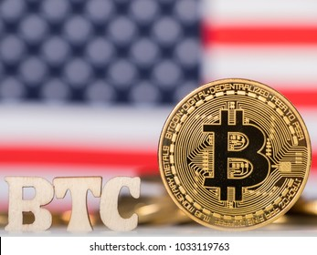 Bitcoin and BTC text against USA flag background