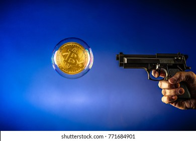 bitcoin in a bubble and pistol aiming at at the bitcoin