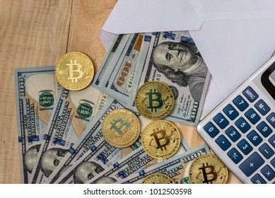 Bitcoin and calculator on dollar bills