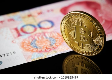 Bitcoin with Chinese yuan banknote