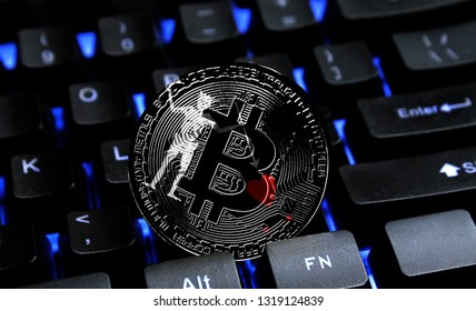 Bitcoin close-up on keyboard background, the flag of Blackbeard Pirate is shown on bitcoin.