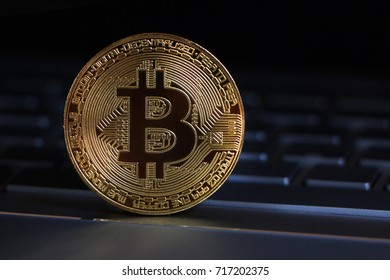Bitcoin close-up on keyboard background.
