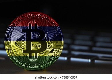 Bitcoin close-up on keyboard background, the flag of Mauritius is shown on bitcoin.