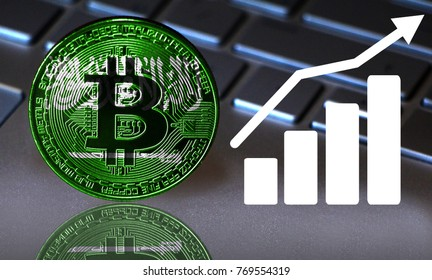 Bitcoin close-up on the keyboard background, the Saudi Arabia flag is shown on the bitcoin.