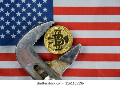BITCOIN coin being squeezed in vice on USA flag background; concept of cryptocurrency bitcoin (btc) under pressure. Prohibition of cryptocurrencies, regulations, restrictions or security