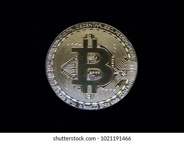 Bitcoin coin close up on black background