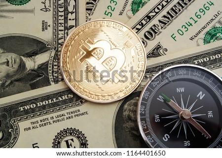 bitcoin-coin-compass-on-money-450w-11644