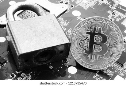 Bitcoin coin as crypto currency symbol and padlock on computer circuit board, bitcoin safety concept