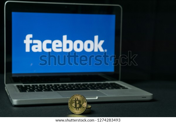 Bitcoin coin with the Facebook logo on a laptop screen, Slovenia - December 23th, 2018