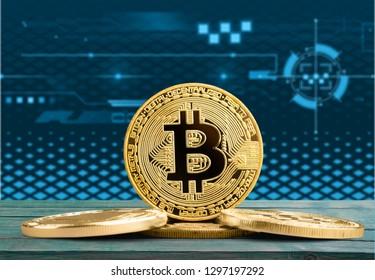Bitcoin coin in front of Bakkt website.          - Image