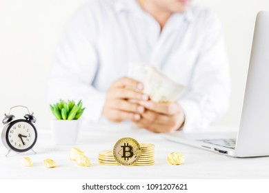 Bitcoin coin golden coin in the glass jar on wooden table ,Man trading cryptocurrency or bitcion.Set of cryptocurrencies with a golden bitcoin as most important cryptocurrency concept.