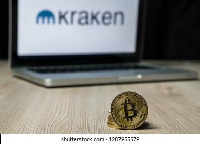 Bitcoin coin with the Kraken exchange logo on a laptop screen, Slovenia - December 23th, 2018