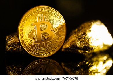 Bitcoin coin and mound of gold nuggets bitcoin cryptocurrency