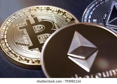 bitcoin coin next to ethereum coins