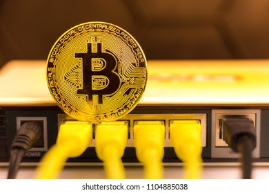 Bitcoin coin on the back of a router, symbolizing it's a web money.