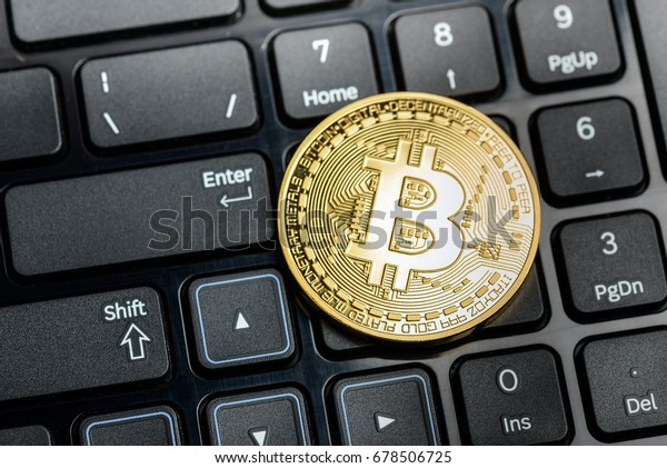 bitcoin coin on black keyboard background