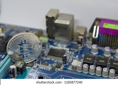 bitcoin coin on the computer mainboard