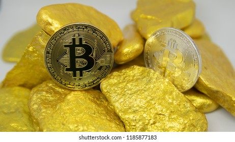 bitcoin coin on gold chunks
