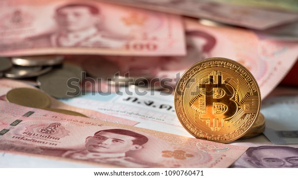Bitcoin coin With Thai currency, Concept Determining the tax law of digital money. (Translations text in the image = Message means tax payment Show on paper Annual Tax Payment Statement in Thailand)