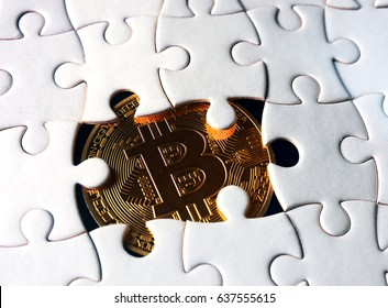 bitcoin coin under puzzle