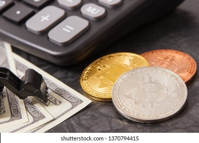 Bitcoin coins, calculator, dollar and miniature excavator, symbol of mining cryptocurrency, modern finance and international network payment