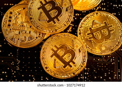 Bitcoin coins. Integrated circuits and bitcoins as a symbol of electronic currency. Shallow depth of field.