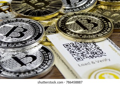 Bitcoin coins laying on paper wallet with QR code
