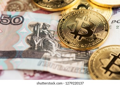 Bitcoin coins (new virtual money) on Russian banknotes A close up image of bitcoins with Russian rubles banknotes Bitcoin coin on the background of Russian rubles Bitcoin Russia Ruble Cryptocurrency