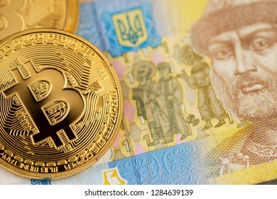 Bitcoin coins new virtual money on Ukraine banknotes close up image of bitcoins with Ukraine hryvnia banknotes Bitcoin coin on the background of Ukraine hryvnia Bitcoin Ukraine Hryvnia Cryptocurrency
