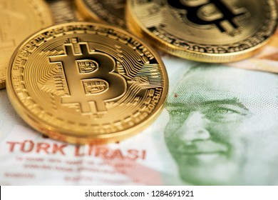 Bitcoin coins new virtual money on Turkish banknotes close up image of bitcoins with turkish lira banknotes Bitcoin coin on the background of Turkey lira  Bitcoin and Turkey national currency bitcoin