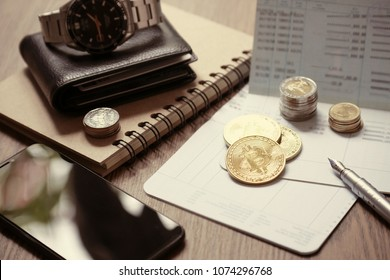 Bitcoin coins on bankbook with stack of coins use for cryptocurrency business and finance background. saving and trading money concept.