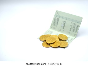 Bitcoin coins on bankbook. Use for cryptocurrency business and finance background.