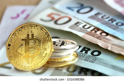 Bitcoin coins on Euro banknote, Cryptocurrency concept photo