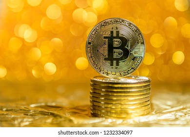 bitcoin coins on a gold background