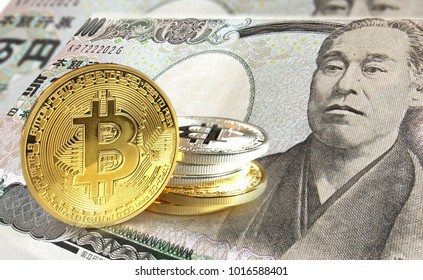 Bitcoin coins on Japanese Yen  banknote, Cryptocurrency concept photo