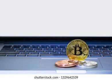 Bitcoin coins on laptop computer track pad