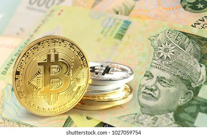 Bitcoin coins on Malaysian Ringgit banknote, Cryptocurrency concept photo