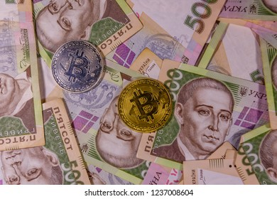 Bitcoin coins on ukrainian five hundred hryvnas banknotes