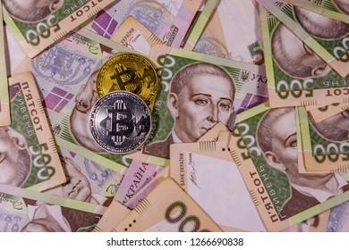 Bitcoin coins on ukrainian five hundred hryvnas banknotes