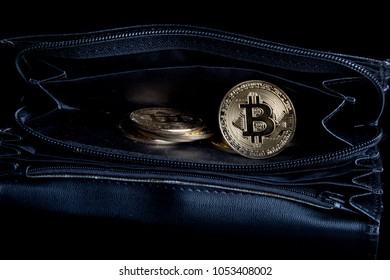 A bitcoin concept of coins spilling out of a purse