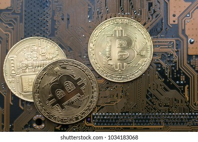 bitcoin concept - gold coin, computer circuit Board with bitcoin processor and microchips. Electronic currency, Internet Finance