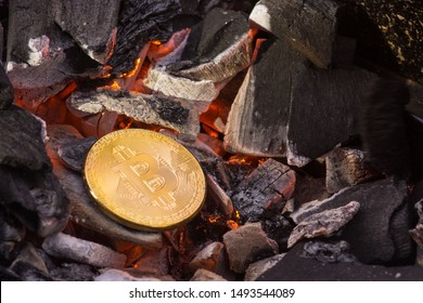 Bitcoin concept, a golden bitcoin token being heated on charcoal grill.